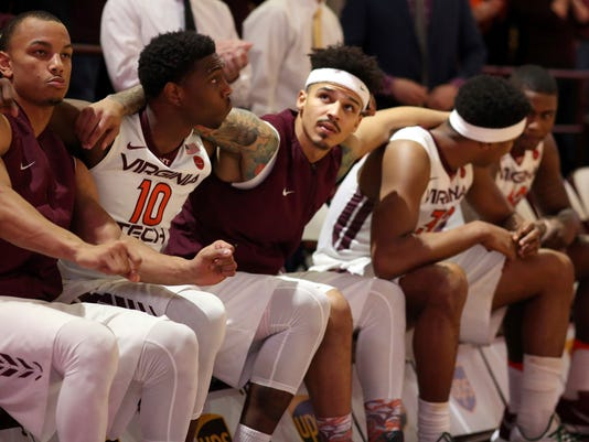 Virginia Tech starters, form left, Justin Robinson. Justin Bibbs (10), Seth Allen, Zach LeDay (32) and Ty Outlaw (42) sit on the bench before the team's NCAA college basketball game against Wake Forest in Blacksburg, Va., Saturday, March 4 2017. (Matt Gentry/The Roanoke Times via AP)