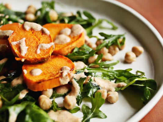 Hearty salad mixes sweet potatoes with nutty, tangy dressing