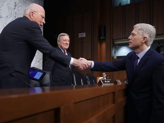 Senate Judiciary Committee members, from left, Sen. Patrick Leahy, D-Vt., and Sen. Richard Durbin, D-Ill., greet Judge Neil Gorsuch during the second day of his Supreme Court confirmation hearing on Capitol Hill last month.