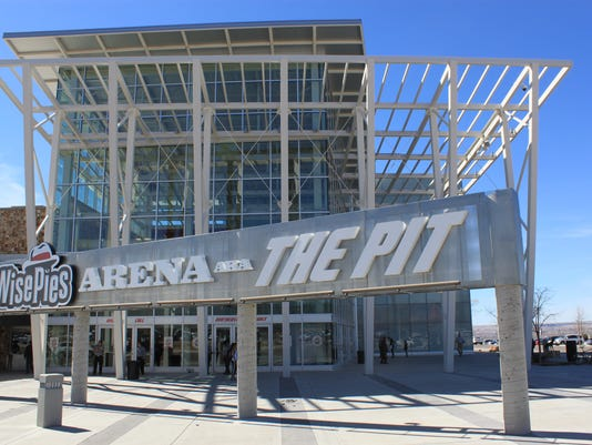 FILE - This March 8 2017, file photo, shows the University of New Mexico arena, known as The Pit, in Albuquerque, N.M. Dreamstyle Remodeling, a home-remodeling business that operates in four states has bought the naming rights for the University of New Mexico's famed basketball arena and its football stadium for $10 million, the school announced Wednesday, May 3, 2017.  (AP Photo/Susan Montoya Bryan, File)