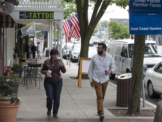 Pedestrians walk through downtown Toms River.
