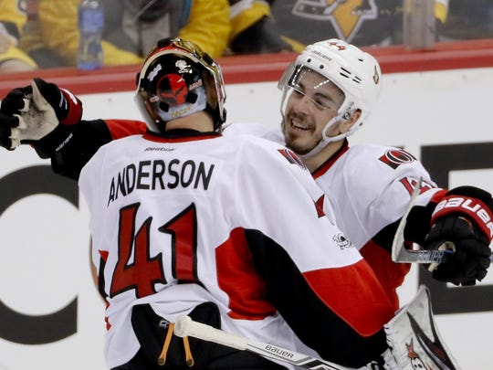 Ottawa Senators' Jean-Gabriel Pageau, right, celebrates with goalie Craig Anderson after defeating the Pittsburgh Penguins in the overtime period of Game 1 of the Eastern Conference final in the NHL hockey Stanley Cup playoffs, Saturday, May 13, 2017, in Pittsburgh. Ottawa won 2-1 in overtime. (AP Photo/Gene J. Puskar)