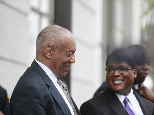 Bill Cosby leaves Montgomery County Courthouse in Norristown, Pa., with his spokesman, Andrew Wyatt.