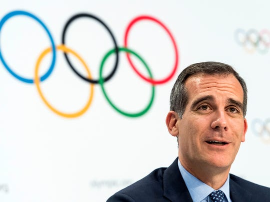 FILE - In this July 11, 2017 file photo Mayor of Los Angeles Eric Garcetti speaks, during a press conference after the International Olympic Committee (IOC) Extraordinary Session, at the SwissTech Convention Centre, in Lausanne, Switzerland. It was announced Monday, July 31, 2017 that Los Angeles has reached an agreement with international Olympic leaders that will open the way for the city to host the 2028 Summer Games, while ceding the 2024 Games to rival Paris. (Jean-Christophe Bott/Keystone via AP, File)