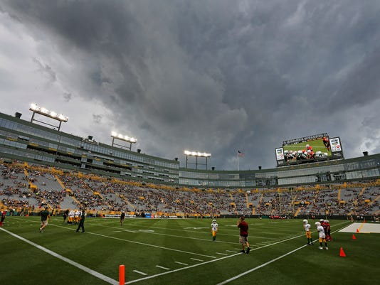 Storm clouds roll in over Lambeau Field prior to a Green Bay Packers' NFL football training camp practice, Saturday, Aug. 5, 2017, in Green Bay, Wis. (AP Photo/Matt Ludtke)