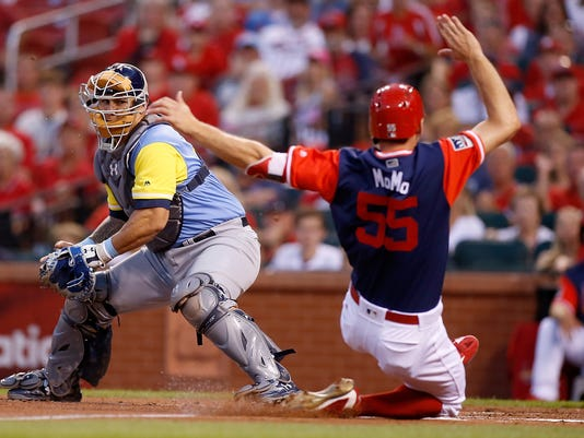 St. Louis Cardinals' Stephen Piscotty, right, scores a run ahead of the tag from Tampa Bay Rays catcher Wilson Ramos during the first inning of a baseball game Friday, Aug. 25, 2017, in St. Louis. (AP Photo/Scott Kane)