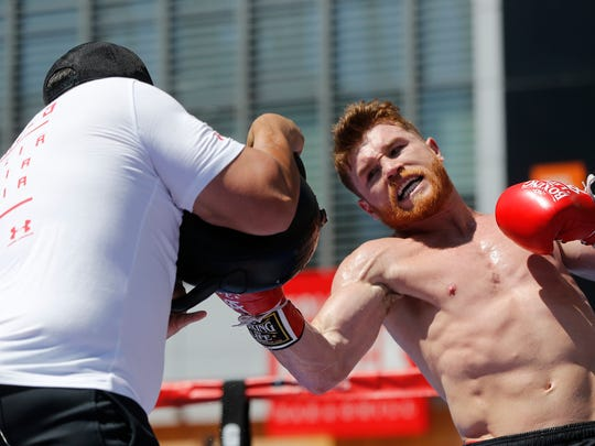 """Boxer Canelo Alvarez works out as he hosts an open-to-the-public media workout at L.A. LIVE in Los Angeles on Monday, Aug. 28, 2017. Canelo Alvarez vs. Gennady """"GGG"""" Golovkin is a 12-round box fight for the middleweight championship of the world presented by Golden Boy Promotions and GGG Promotions. The event will take place Saturday, Sept. 16, 2017, at T-Mobile Arena in Las Vegas. (AP Photo/Damian Dovarganes)"""
