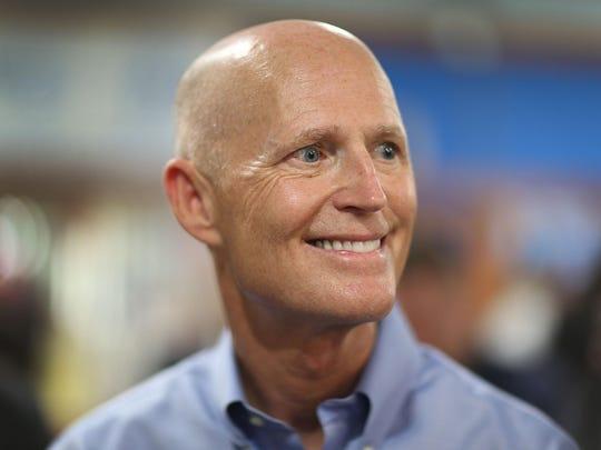 Florida Gov. Rick Scott Holds Bill Signing In Miami Gardens