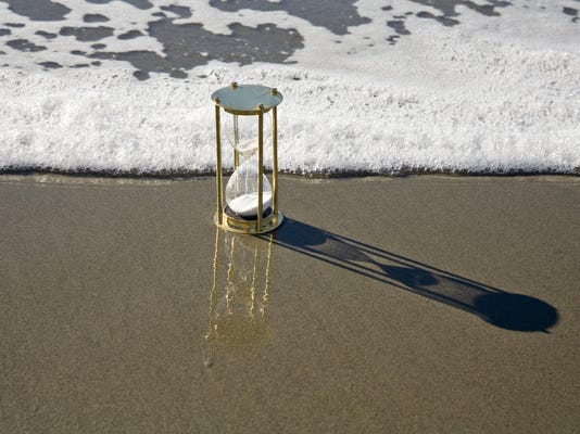 Hourglass Sand Timer and Rising Tide Surf Seashore Beach