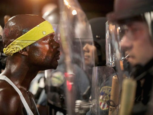 Saturday night's clash between police and a few dozen protesters in the Delmar Loop area of University City, a suburb about 10 miles west of St. Louis near Washington University, resulted in the arrests of at least nine people.
