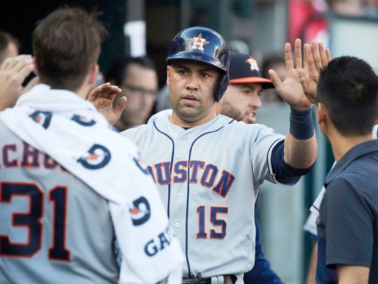 Jul 29, 2017; Detroit, MI, USA; Houston Astros designated hitter Carlos Beltran (15) is congratulated by teammates after scoring in the fourth inning against the Detroit Tigers at Comerica Park. Mandatory Credit: Rick Osentoski-USA TODAY Sports ORG XMIT: USATSI-351968 ORIG FILE ID:  20170729_szo_aa1_021.JPG