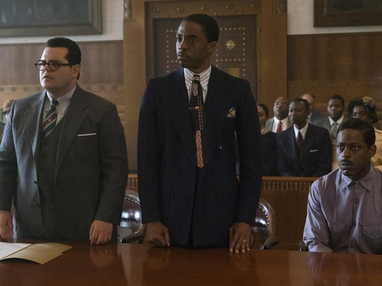 Josh Gad, from left, Chadwick Boseman, who portrays