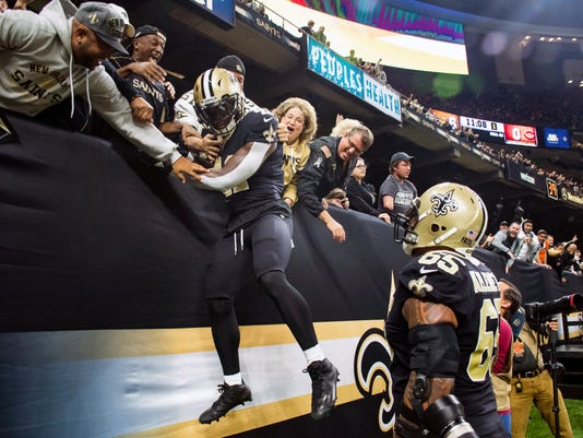 New Orleans Saints running back Alvin Kamara jumps into the stands after scoring a touchdown against the Chicago Bears during an NFL football game Sunday, Oct. 29, 2017, in New Orleans. (Scott Clause/The Daily Advertiser via AP)
