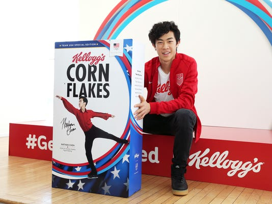 In this Monday, Oct. 30, 2017, photo, U.S. Olympic hopeful Nathan Chen poses with a Kellogg's corn flakes box featuring him at the Team Kellogg's 100 Days Out celebration in New York. (Mark Von Holden/AP Images for The Kellogg Company)