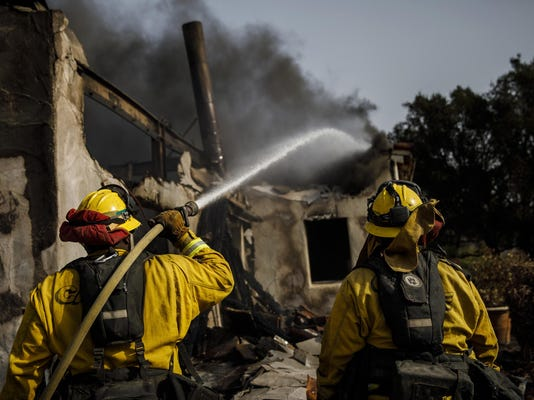 California wildfire continues to grow as strong shifting winds bring new dangers