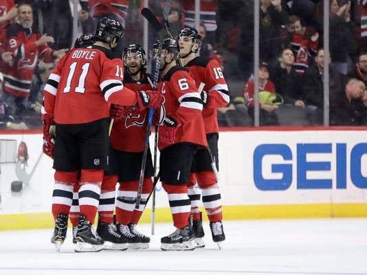 buy online 4cb5b b614c Schneider, Hall lead Devils over Blackhawks 4-1