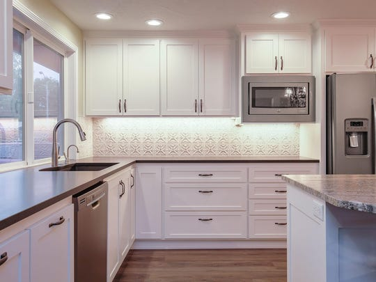 Under-cabinet lighting makes the backsplash shine in this Keizer kitchen.