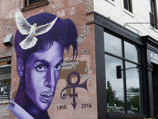 A mural honoring the late musical genius Prince adorns