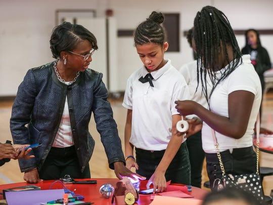 Boler-Davis talks with second- through sixth-grade students at the Detroit International Academy in September during a Science, Technology, Engineering and Math-focused activity in celebration of the GM-Black Girls Code partnership.