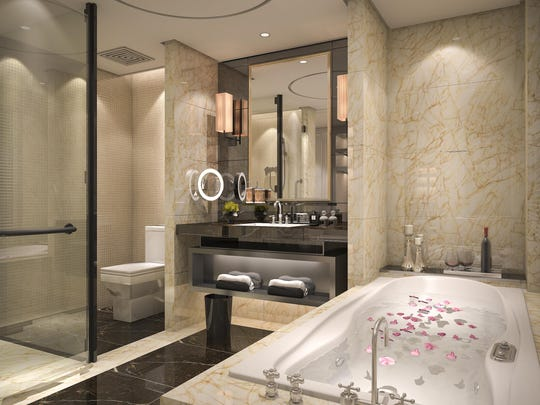 Features like metallics, high-tech toilets, fancy light fixtures, a huge shower, and marble walls can add luxury to a bathroom remodel.