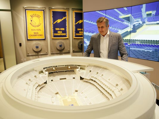 In this photo taken Jan. 24, 2018, Golden State Warriors President and COO Rick Welts looks over a model of Chase Center at the Chase Center Experience in San Francisco. Welts, who turned 65 in January and is the first openly gay NBA executive, can lean not only on the time with the Seattle SuperSonics but also his experience in the league office and with Phoenix to see what things work and don't work when it comes to operating a franchise, to building an arena. (AP Photo/Eric Risberg)