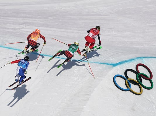 From left, Arnaud Bovolenta, of France, Dave Duncan, of Canada, Kevin Drury, of Canada, and Russian athlete Sergey Ridzik run the course during the men's ski cross semifinal at Phoenix Snow Park at the 2018 Winter Olympics in Pyeongchang, South Korea, Wednesday, Feb. 21, 2018. (AP Photo/Felipe Dana)