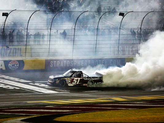 Kyle Busch celebrates after winning the NASCAR Truck Series auto race at Las Vegas Motor Speedway in Las Vegas on Friday, March 2, 2018. (Andrea Cornejo/Las Vegas Review-Journal via AP)