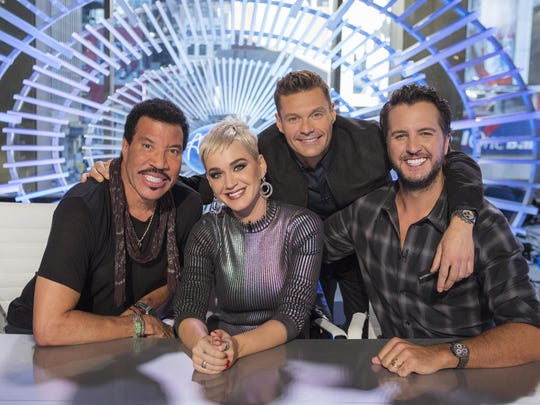 "This image released by ABC shows, from left, Lionel Richie, Katy Perry, Ryan Seacrest and Luke Bryan in New York. Richie, Perry and Bryan are the judges on the next season of ""American Idol,"" premiering March 11 on ABC."