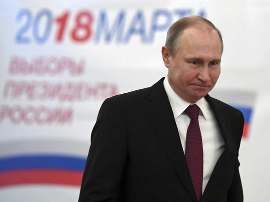 Russian President and Presidential candidate Vladimir Putin arrives to vote at a polling station during Russia's presidential election in Moscow, Russia, Sunday, March 18, 2018. Putin's victory in Russia's presidential election Sunday isn't in doubt. The only real question is whether voters will turn out in big enough numbers to hand him a convincing mandate for his fourth term, and many Russian workers are facing intense pressure to do so. (Yuri Kadobnov/Pool Photo via AP)