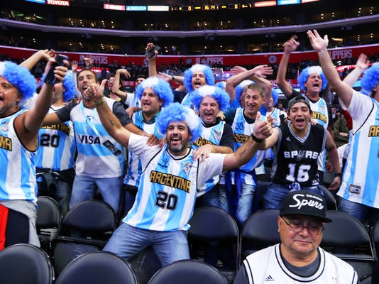 Fans of San Antonio Spurs guard Manu Ginobili, who is from Argentina, cheer before an NBA basketball game against the Los Angeles Clippers in Los Angeles, Tuesday, April 3, 2018. (AP Photo/Reed Saxon)