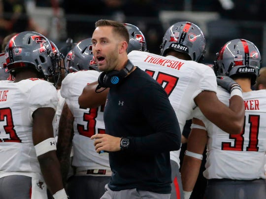 FILE - In this Nov. 11, 2017, file photo, Texas Tech Head Football coach Kliff Kingsbury on the sidelines against Baylor in the first half of an NCAA college football game, in Arlington, Texas. Kingsbury is still popular at Texas Tech, five years after his hiring as coach unified a fractured football program at his alma mater. (Jerry Larson/Waco Tribune-Herald via AP, File)