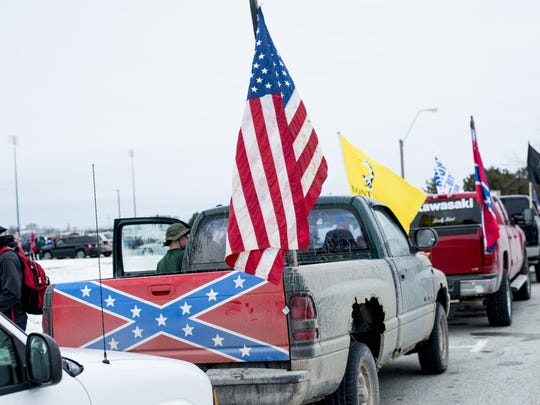 Confederate flag-bearing trucks met with opposition outside Bay City Western High
