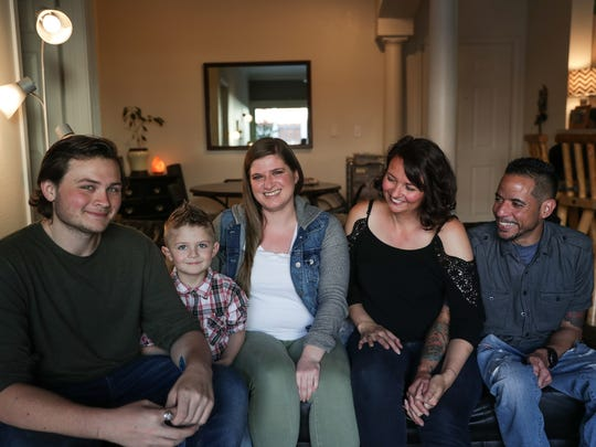 Korbin Vogler, 16, Drayk Vogler, 4, Sarah Brook, Drayk's babysitter, Marcy Vogler, mother of Drayk and Korbin, and Orlando Perez, Marcy's fiancé, pose for a photo at their home in Salt Lake City on Tuesday, May 15, 2018.