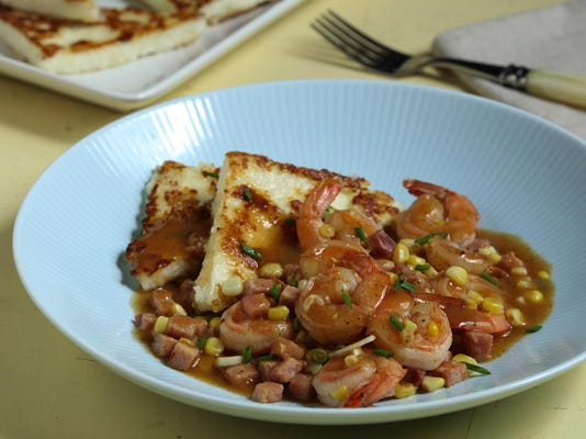 Grits cakes make crispy cushion for spicy shrimp