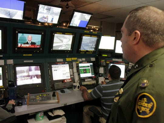 A border patrol agent looks over security screens in the command center in Swanton. The Swanton sector encompasses the U.S.-Canada border with Vermont, New Hampshire and northern New York.
