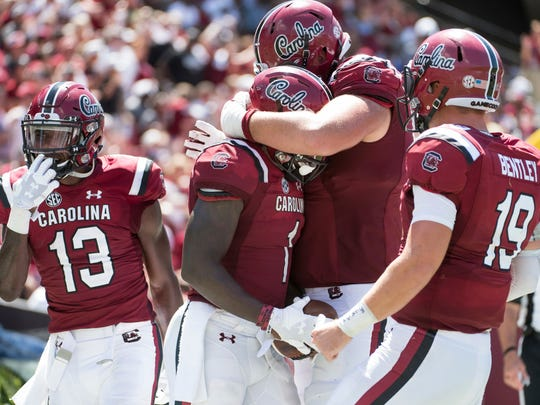 South Carolina wide receiver Deebo Samuel (1) celebrates his touchdown reception with Blake Camper, right, Jake Bentley (19), and Shi Smith (13) during the second half of an NCAA college football game against Coastal Carolina Saturday, Sept. 1, 2018, in Columbia, S.C. South Carolina defeated Coastal Carolina 49-15. (AP Photo/Sean Rayford)