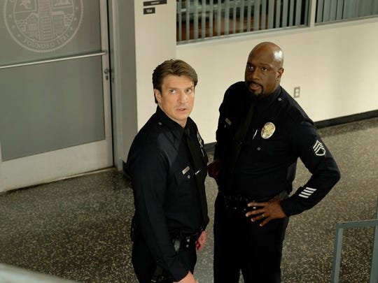 Nathan Fillion (left) and Richard T. Jones star in