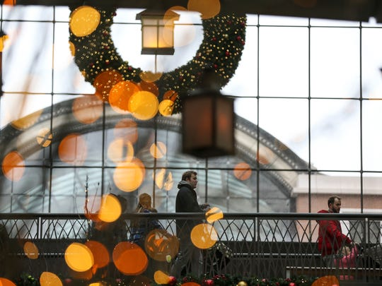 In this file photo, shoppers walk the streets at City Creek center in Salt Lake City.