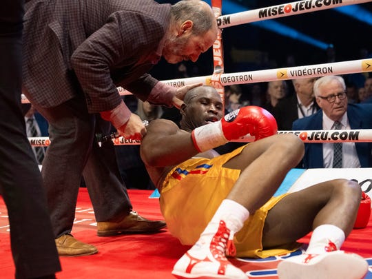 Ring doctor Marc Gagne, left, checks on Adonis Stevenson, of Canada, after he was knocked out by Oleksandr Gvozdyk, of Ukraine, in their light heavyweight WBC championship boxing fight, Saturday, Dec. 1, 2018, in Quebec City. (Jacques Boissinot/The Canadian Press via AP)