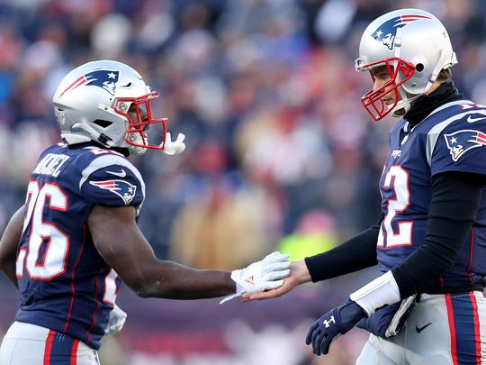 Tom Brady high fives Sony Michel during the Patriots' win over the Chargers on Sunday.