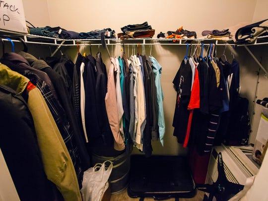 Closet of a man with shirts