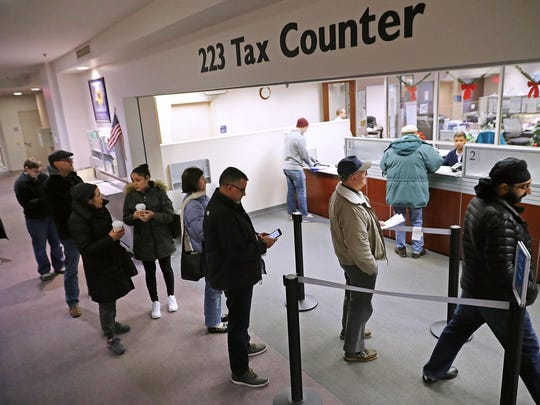 Residents wait in line to pay taxes at the Fairfax County Government Center December 28, 2017 in Fairfax, Virginia.