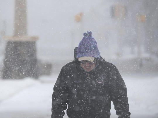 Francis Rotenberger, of Rapid City, S.D., walks home through Memorial Park in the snow in downtown Rapid City Wednesday, March 13, 2019. A window-rattling storm brought blizzards, floods and a tornado across more than 25 states Wednesday, stretching from the northern Rocky Mountains to Texas and beyond. (Ryan Hermens/Rapid City Journal via AP)