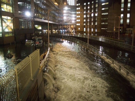 In this Oct. 29, 2012 file photo, seawater floods the entrance to the Brooklyn Battery Tunnel during Superstorm Sandy in New York. Mayor Bill de Blasio is announcing a plan, Thursday, March 14, 2019, to protect lower Manhattan from rising sea levels by surrounding it with earthen berms and extending its shoreline by as much as 500 feet.
