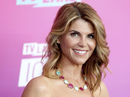 In this April 10, 2016 file photo, actress Lori Loughlin arrives at the TV Land Icon Awards in Santa Monica, Calif. Felicity Huffman and Loughlin have worked steadily as respected actresses and remained recognizable if not-quite-A-list names for decades.