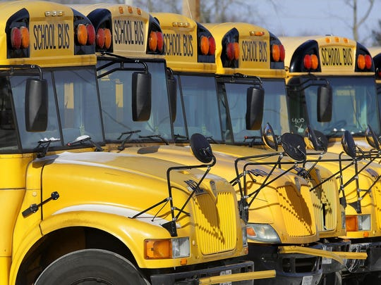 In this Jan. 7, 2015 file photo, public school buses are parked in Springfield, Ill.