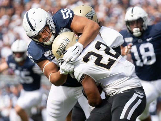 Penn State defensive tackle Antonio Shelton (55) tackles Idaho running back Aundre Carter (22) in the first quarter of an NCAA college football game in State College, Pa., on Saturday, Aug. 31, 2019. (AP Photo/Barry Reeger)