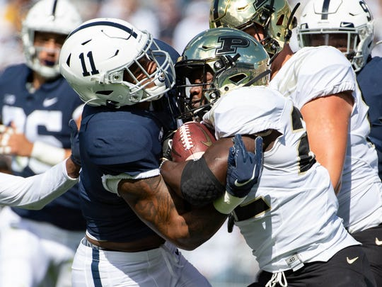 Penn State linebacker Micah Parsons (11) tackles Purdue running back King Doerue (22) in the first quarter of an NCAA college football game in State College, Pa., on Saturday, Oct. 5, 2019. (AP Photo/Barry Reeger)