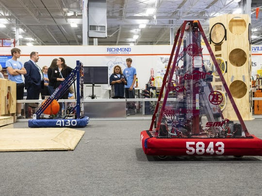 In an Oct. 8, 2019 photo, robots are positioned on the field at the Blue Water Area Robotics Alliance's practice field, at P.J. Wallbank Springs in Port Huron, Mich. The fully-equipped practice field cost $23,000 and meets all FIRST Robotics regulations. (Brian Wells/The Times Herald via AP)