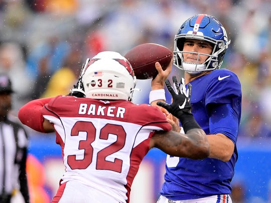 EAST RUTHERFORD, NEW JERSEY - OCTOBER 20:  Daniel Jones #8 of the New York Giants attempts a pass against Budda Baker #32 of the Arizona Cardinals during the first half at MetLife Stadium on October 20, 2019 in East Rutherford, New Jersey. (Photo by Steven Ryan/Getty Images)